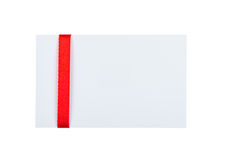 Card with red ribbon bow on white background Stock Images