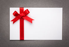 Card with red ribbons bows Royalty Free Stock Image