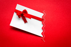 Card with red ribbons bows Stock Photos