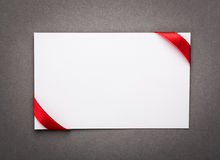 Card with red ribbons bows Royalty Free Stock Photography