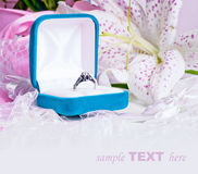 Card with ring, gloves and flowers Royalty Free Stock Photos