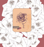 Card with rose and inscription scattered on the surface. Theme selection. Vintage style. Royalty Free Stock Photos