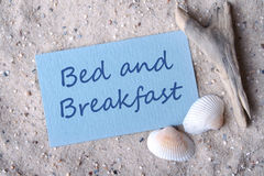 Bed and breakfast. Card, sand and shells with lettering bed and breakfast Royalty Free Stock Image