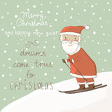 Card with Santa on skis. Stock Photo