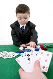 Card Shark. Two year old boy in a 3 piece suit playing poker.  Shot with the Canon 20D Stock Image