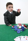 Card Shark. Two year old boy in a 3 piece suit playing poker.  Shot with the Canon 20D Royalty Free Stock Photos