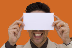 A card with a smile. A elegant businessman with a bank card over his smile Stock Photo