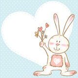 Card with smiling toy bunny holding flowers Royalty Free Stock Image