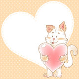 Card with smiling toy cat holding heart Royalty Free Stock Photography
