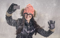 With card in snowfall Royalty Free Stock Photo