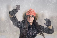 With card in snowfall Stock Photos