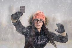 With card in snowfall Stock Photos