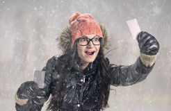 With card in snowfall Royalty Free Stock Image