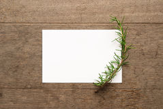 Card for someone special. Decorated with rosemary on wood background Royalty Free Stock Photos