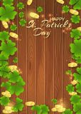 Card of St. Patrick`s Day with gold coins and clover leaves Royalty Free Stock Photo