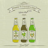 Card for St. Patrick's Day with three bottles of beer Stock Images