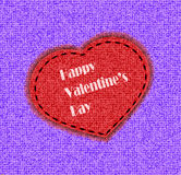 Card by a St. Valentine's Day heart from fabric is sewed on a color background Stock Photo
