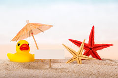 Card, starfishes and umbrella Royalty Free Stock Photos