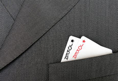 Card Suit. The Joker, Gambling Cards In A Suit Jacket Pocket Royalty Free Stock Photos