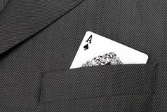 Card Suit. Ace Of Spades Gambling Card In A Suit Jacket Pocket Stock Photos