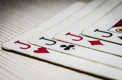 Card suits. On the table laid out four jacks of different suits Royalty Free Stock Images