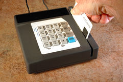 Card swipe. Credit card being swiped to process a sales transaction Stock Photo