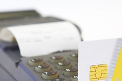 Card swiper and credit card. Credit card close up, remote swiper in dof royalty free stock photos
