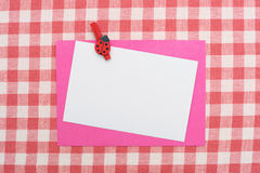 Card on tablecloth Royalty Free Stock Images