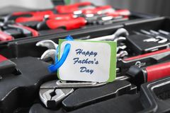 Card with text Happy Father`s Day and set. Of tools in box, closeup Royalty Free Stock Photography
