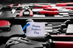 Card with text Happy Father`s Day and set of tools. In box, closeup Royalty Free Stock Image