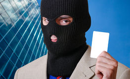 Card thief. The thief is holding credit card Stock Photo