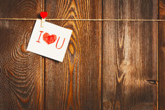 Card to day of St. Valentine and red heart on wooden Stock Photography