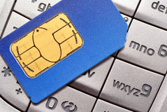 Card to mobile phone. Card (SIM) into the mobile phone is the keypad on your mobile stock photography