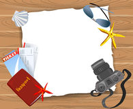 Card with travel items on a wooden background Royalty Free Stock Images