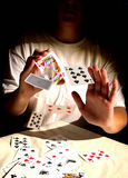 Card Tricks. Woman with playing cards Stock Photography
