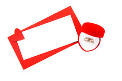 Card for Valentine's Day and a gift of a gold ring Royalty Free Stock Photography