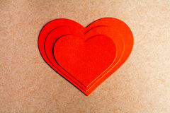 Card for a Valentine's day. Three red paper heart Stock Image