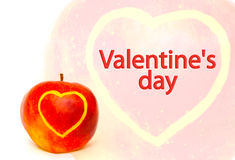Card - Valentines Day. The image of the apple on which heart is cut out Stock Photos