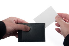 Card and wallet. Inserting a business card into a wallet Royalty Free Stock Photography