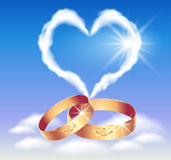 Card with wedding rings and heart Royalty Free Stock Images