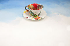 Card with white cup and a saucer smudged with paint Stock Images