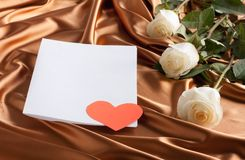 Card with white roses and a paper heart Royalty Free Stock Photo