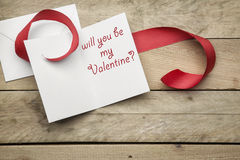 Card Will you be my valentine on wooden background Royalty Free Stock Photo