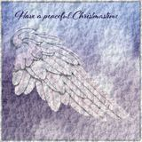 Christmas Card with Angel Wing and snow background. Card with wooden angel wing on snowy background in light blue and rose pink Royalty Free Stock Photography