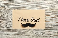 Card with words I LOVE DAD. On wooden background, top view. Father`s day celebration Stock Photos