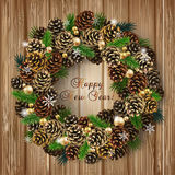 Card with wreath of fir cones, branches and beads. Card for the winter holidays with a realistic wreath of fir cones, fir branches and beads on wood background Stock Images