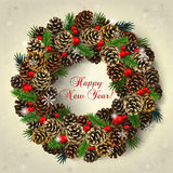 Card with wreath of fir cones, branches and red beads Royalty Free Stock Photography