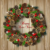 Card with wreath of fir cones, branches and red beads Royalty Free Stock Image