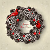 Card with wreath of fir cones and redbirds. Card for the winter holidays with a realistic wreath of fir cones and redbirds. Place for text. Christmas and New Royalty Free Stock Photo