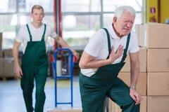 Cardíaco de ataque no local de trabalho Imagens de Stock Royalty Free